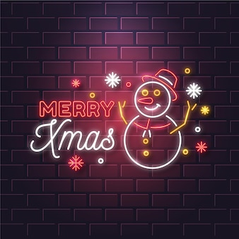 Texto de neón feliz navidad con muñeco de nieve