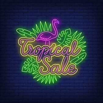Texto de neón de venta tropical con flamingo y hojas