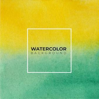 Textura de acuarela pintada a mano de color amarillo y verde sobre fondo blanco.