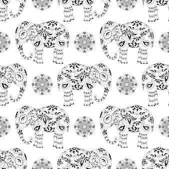 Textura sin fin con elefantes estampados estilizados y mandala en estilo indio.