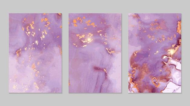 Texturas abstractas de mármol lila y dorado.