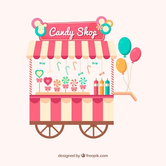 Tienda de caramelos con globos sobre ruedas