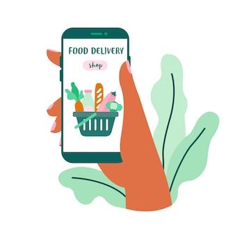 Tienda de comida a domicilio en línea en la pantalla. mano que sostiene la ilustración del teléfono inteligente.
