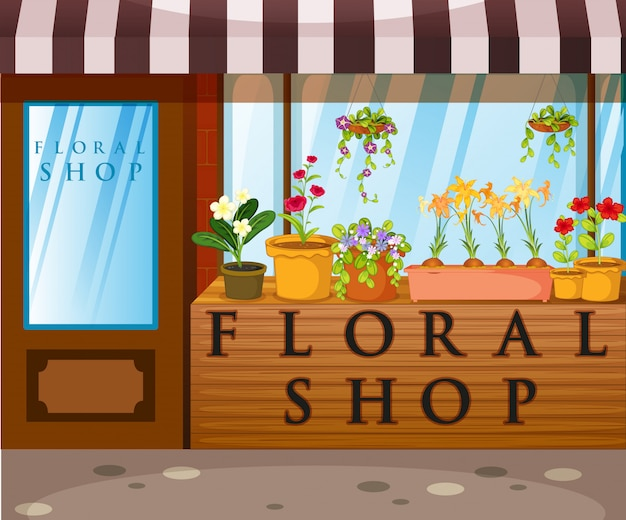 Tienda de flores con hermosas flores en el frente