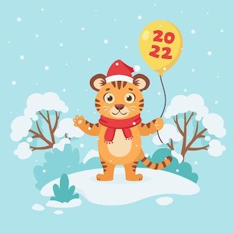 Tigre lindo en una bufanda con un globo 2022 Vector Premium