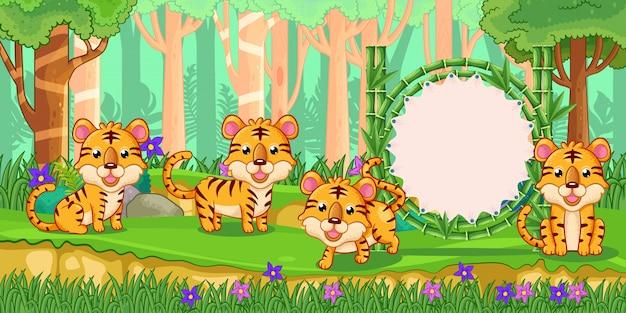 Tigres con un cartel de bambú en blanco en el bosque