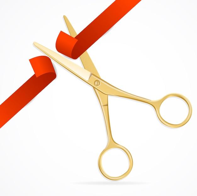 Tijeras cortan la cinta roja. el símbolo del gran evento de inauguración.