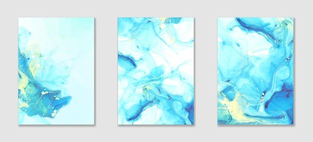 Tinta de alcohol líquido azul abstracto y fondo de acuarela con manchas doradas