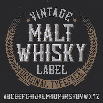 Tipografía de etiqueta vintage llamada whisky de malta. buena fuente para usar en etiquetas o logotipos antiguos.