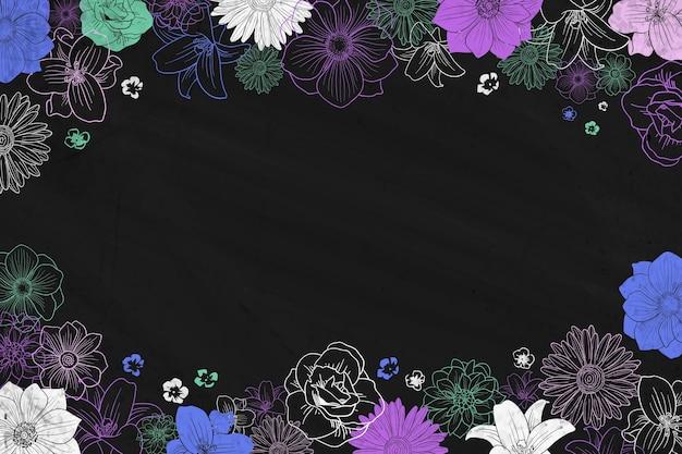 Tiza sobre pizarra y marco floral de fondo