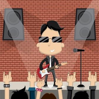 Él está tocando en un concierto de rock