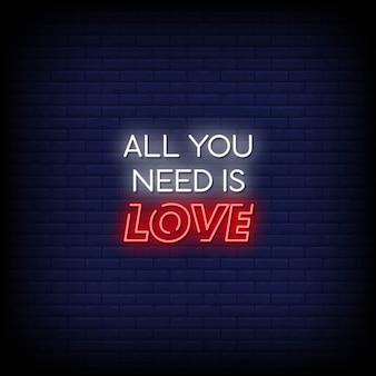 Todo lo que necesitas es amor texto de estilo de letreros de neón