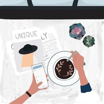 Tomar un café con leche y consultar las redes sociales