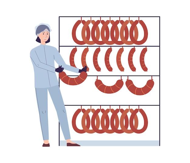 Trabajador de una fábrica de salchichas colgando comida en la rejilla - mujer de dibujos animados aislada en uniforme industrial con carne ahumada procesada