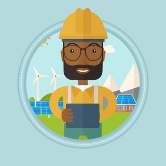 Trabajador de sexo masculino de la planta de energía solar