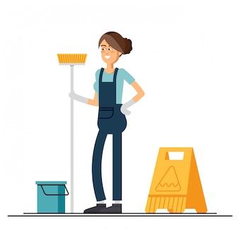 La trabajadora del servicio de limpieza está sosteniendo una fregona.