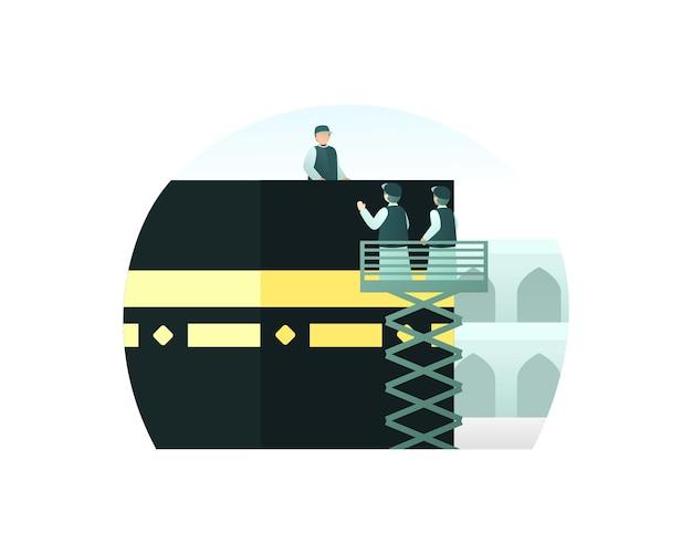 Los trabajadores cambian el paño de la kaaba