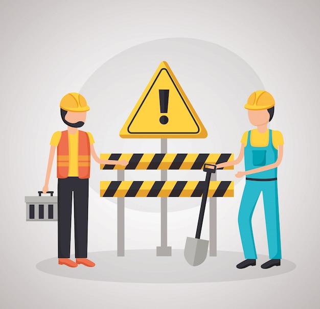 Trabajadores de la construcción barrera pala
