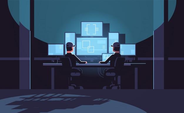 Trabajadores de seguridad mirando cámaras de video vigilancia