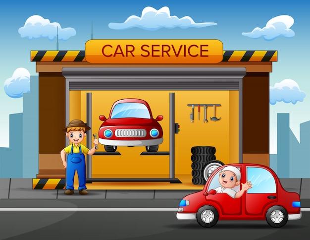Trabajadores del servicio de taller de reparación de automóviles que arreglan el automóvil