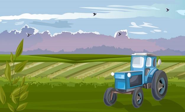 Tractor azul en el campo verde