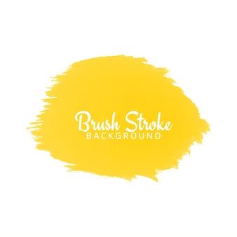 Trazo de pincel acuarela amarillo abstracto sobre blanco