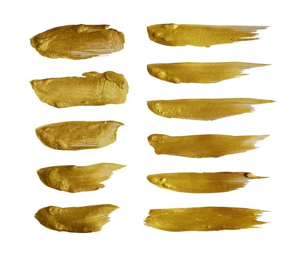 Trazo de pincel de oro aislado