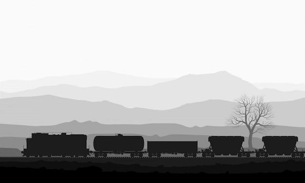 Tren con vagones de mercancías sobre enormes montañas.