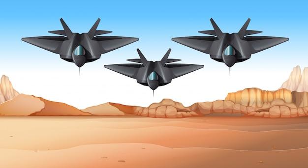 Tres aviones de combate volando sobre el desierto
