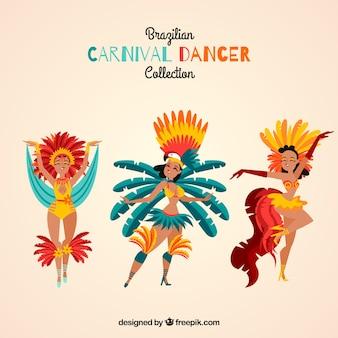Tres bailarines de carnaval brasileño