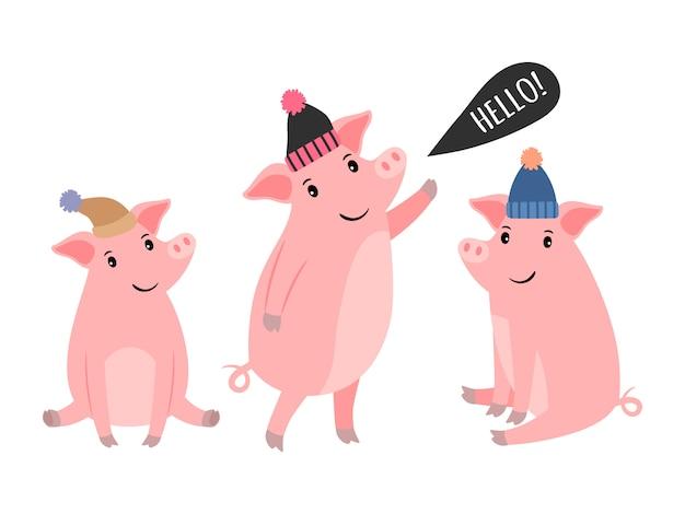 Tres cerdito en sombreros de invierno