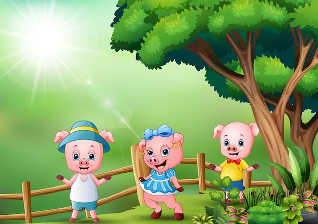 Tres cerditos jugando en la naturaleza.