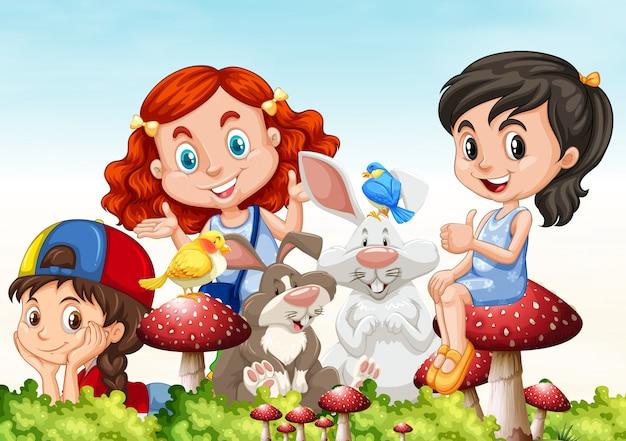 Tres chicas y conejos en el jardín.