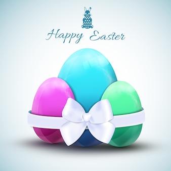 Tres coloridos huevos de pascua con ilustración de vector realista de lazo blanco