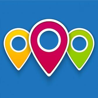 Tres coloridos punteros mapa