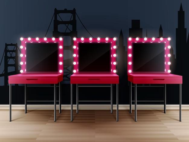 Tres espejos de maquillaje rosa con mesas