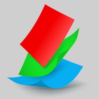 Tres hojas de papel de colores cayendo
