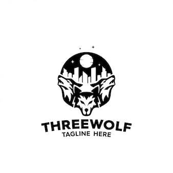 Tres lobos controlan una ciudad por la noche para logo