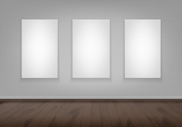 Tres maquetas blancas vacías en blanco marco de imagen de cartel en la pared