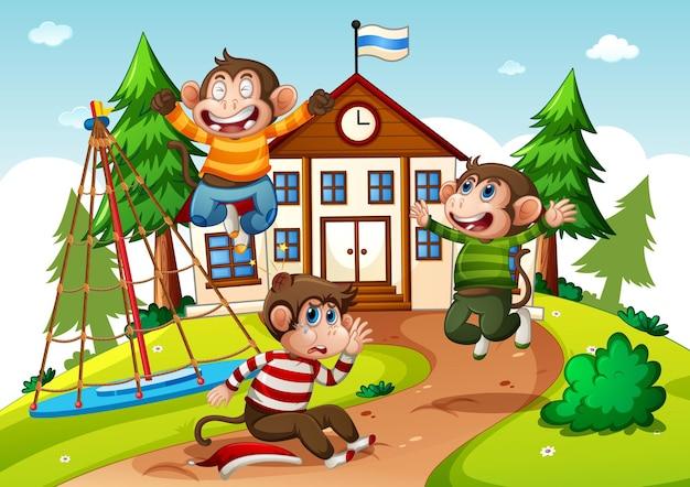 Tres monos jugando en la escena escolar.