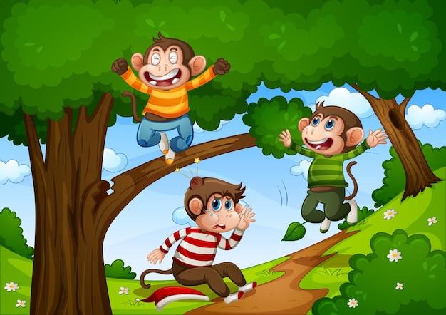 Tres monos saltando en la escena de la jungla.