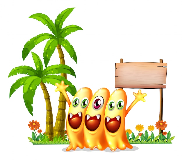 Tres monstruo naranja feliz frente a la señalización de madera vacía