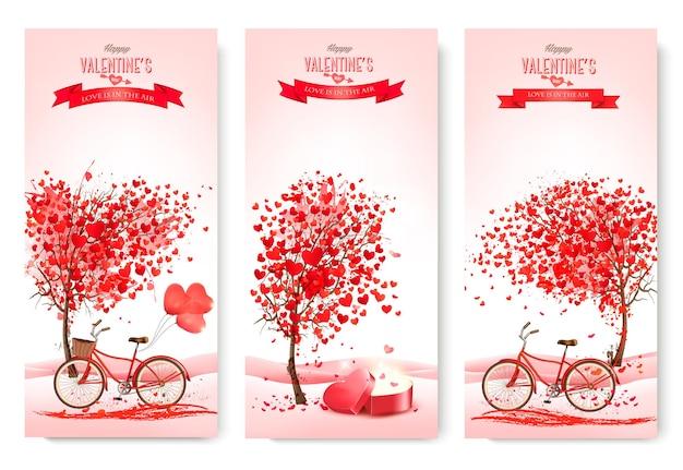 Tres pancartas del día de san valentín con árboles y corazones rosados.