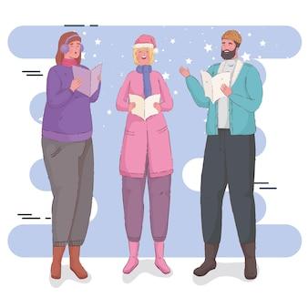 Tres personas cantando villancicos