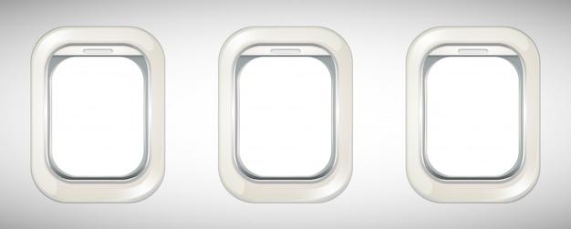 Tres ventanas de avión con pantalla abierta