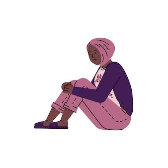 Triste mujer deprimida sentada en el suelo