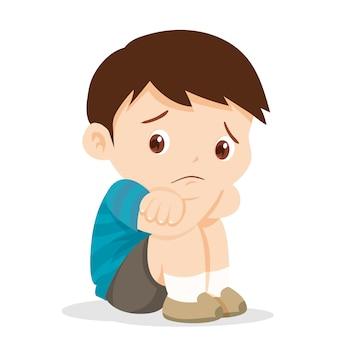 Triste niño sentado solo
