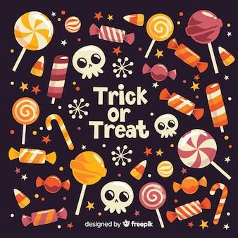 Truco o trato dulces de halloween sobre fondo negro