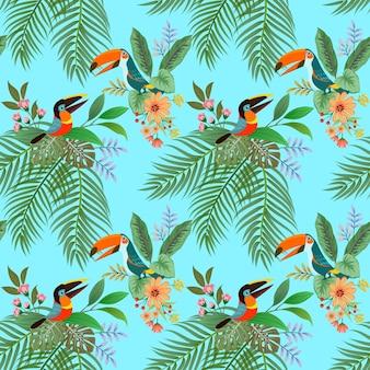 Tucán pájaro y flores de patrones sin fisuras sobre fondo azul.