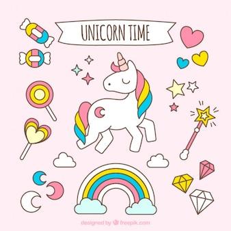 Unicornio adorable con accesorios dibujados a mano
